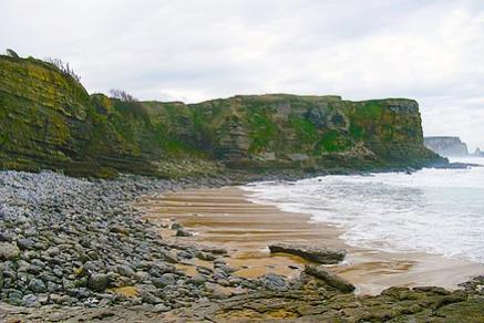 Aparece un cuerpo en la playa de Las Arenillas de Galizano